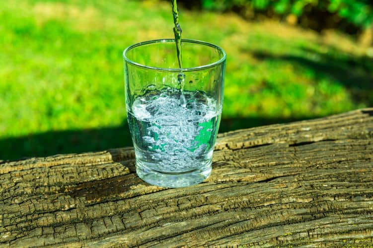 glass of water on top of the wood