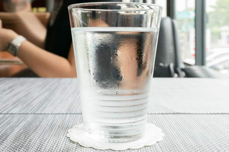 a glass of water on top of a table