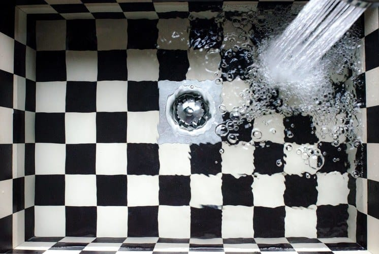 Water Flowing on White and Black Checked sink