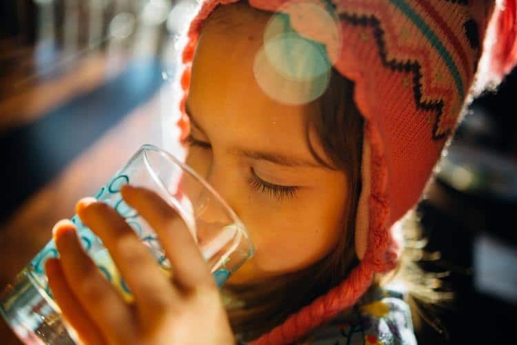 A girl drinking a glass of water